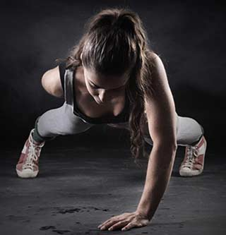 Zone 30 woman doing one-arm pushup